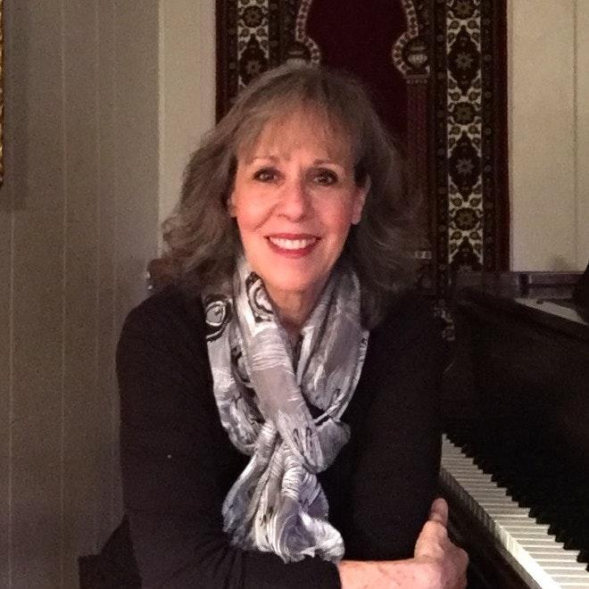 Janine E.