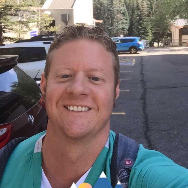 Travis E.
